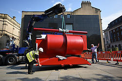 © London News Pictures. Gallery assistants install the seven-tonne, five-metre wide painted steel sculpture Aurora (2000–3) by Sir Anthony Caro in central Leeds, northern England on July 1, 2015. Europe's largest celebration of the artist's work, Caro in Yorkshire; an exhibition organised by the Yorkshire Sculpture Triangle opens on July 18, 2015 across four museums in the region. Photo credit: Oli Scarff/LNP