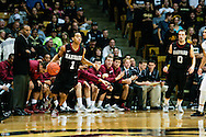 November 24th, 2013:  Harvard Crimson sophomore guard Siyani Chambers (1) runs a play in front of his head coach Tommy Amaker in the second half of action in the NCAA Basketball game between the Harvard Crimson and the University of Colorado Buffaloes at the Coors Events Center in Boulder, Colorado