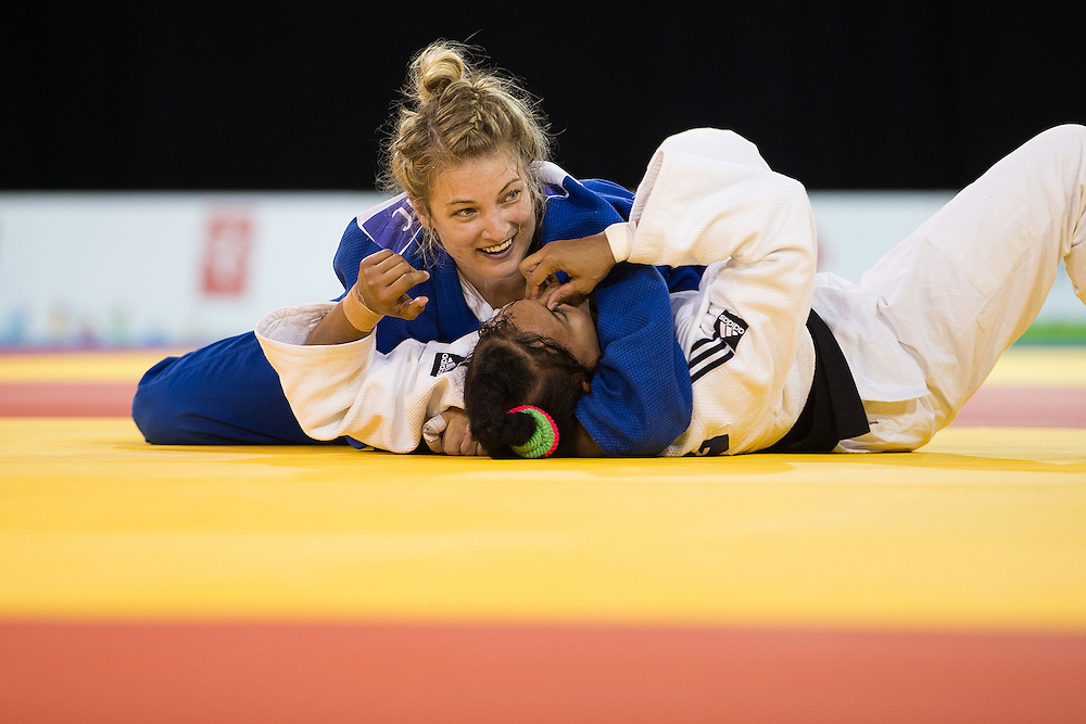 Kelita Zupancic (Top) of Canada smiles as she pins Onix Cortes of Cuba to win the gold medal in the women's judo -70kg class at the 2015 Pan American Games in Toronto, Canada, July 13,  2015.  AFP PHOTO/GEOFF ROBINS