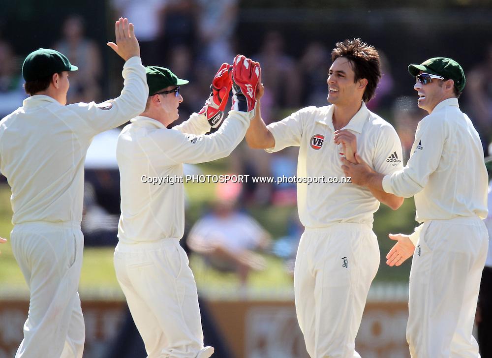 Australian players and bowler Mitchell Johnson celebrate the dismissal of Matthew Sinclair.<br />Test Match Cricket. 2nd test. Day 2.<br />New Zealand Black Caps versus Australia. Seddon Park, Hamilton, New Zealand. Sunday 28 March 2010. <br />Photo: Andrew Cornaga/PHOTOSPORT