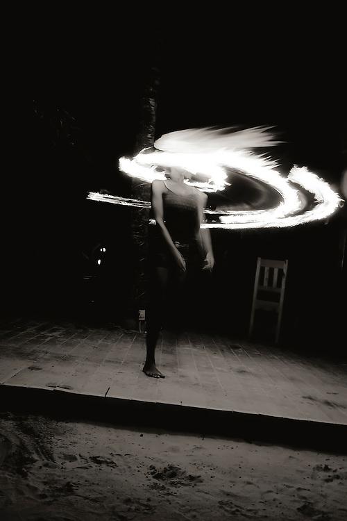 Fire dancer performs at Bananarama Resort in Roatan, Honduras. Copyright 2010 Reid McNally.