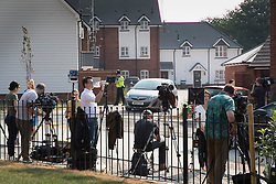 © Licensed to London News Pictures. 04/07/2018. Amesbury, UK. TV crews and reporters gather opposite a property in Muggleton Road, Amesbury after a couple named locally as Dawn Sturgess, 44, and her partner Charlie Rowley, 45, were taken ill on Saturday 30th June 2018. Police have confirmed that the couple have been in contact with Novichok nerve agent. Former Russian spy Sergei Skripal and his daughter Yulia were poisoned with Novichok nerve agent in nearby Salisbury in March 2018.Photo credit: Peter Macdiarmid/LNP