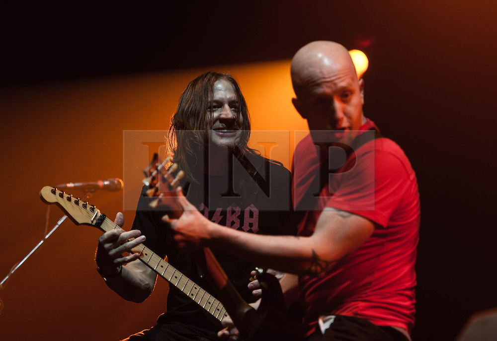 © Licensed to London News Pictures. 28/10/2012. London, UK.   Whitfield Crane (left) and Dave Fortman (right) of Ugly Kid Joe performing live at Wembley Arena supporting Alice Cooper  as part of Alice Cooper's Halloween Night of Fear.  Ugly Kid Joe is an American rock band from Isla Vista, California, formed in 1990. The band's name spoofs that of another band, Pretty Boy Floyd. Ugly Kid Joe's sound includes a range of styles, including hard rock, funk metal and heavy metal..To date, Ugly Kid Joe has released three full-length albums, two compilation albums and two EPs. Their best selling records are As Ugly as They Wanna Be (1991) and America's Least Wanted (1992), which were both certified double platinum by the RIAA; the former is notable for being the first EP to go platinum.[2] The band broke up in 1997, but announced a reunion in 2010.  Photo credit : Richard Isaac/LNP