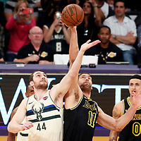 30 March 2018: Jump ball between Milwaukee Bucks center Tyler Zeller (44) and Los Angeles Lakers center Brook Lopez (11) during the Milwaukee Bucks 124-122 victory over the LA Lakers, at the Staples Center, Los Angeles, California, USA.