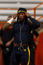 Oct 21, 2011; Syracuse NY, USA;  West Virginia Mountaineers defensive end Bruce Irvin (11) warms up before the game against the Syracuse Orange at the Carrier Dome.  Syracuse defeated West Virginia 49-23. Mandatory Credit: Jason O. Watson-US PRESSWIRE
