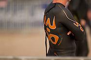 Competitor wearing Orca 3.8 wetsuit. Urban Geelong 2.80.20 Triathlon. 2012 Geelong Multi Sport Festival. Eastern Beach, Geelong, Victoria, Australia. 12/02/2012. Photo By Lucas Wroe