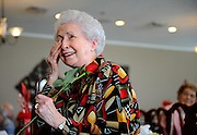 Elise Daniel wipes away tears after being serenaded with love songs by members of the Louisiana Showboat Chorus at the Lake Sherwood Village retirement home. Daniel's daughter surprised her with the singing valentine, which the chorus performed in front of the entire cafeteria...