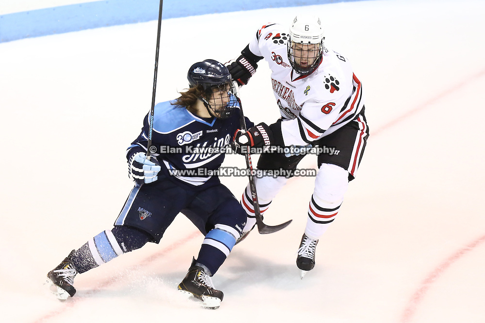 Ryan Lomberg #7 of the Maine Black Bears tries to get past Mike Gunn #6 of the Northeastern Huskies during the game at Matthews Arena on February 22, 2014 in Boston, Massachusetts. (Photo by Elan Kawesch)