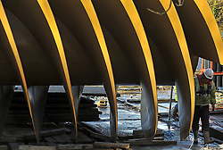 © Licensed to London News Pictures. 20/12/2011, Windsor, UK. A worker makes an inspection to the screw. One of the two giant 40 tonne Archimedes screws is lifted into place at Romney Weir on the River Thames. The screws, the largest in the UK and fish friendly, will generate 300 kilowatts of energy every hour to power Windsor Castle. It is the largest hydropower scheme in the South East of England. Photo credit: Stephen Simpson/LNP