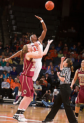 Virginia center Aisha Mohammed (33) wins the opening tip over Boston Coll. center Carolyn Swords (30).  The #21 ranked Virginia Cavaliers defeated the Boston College Eagles 90-70 at the John Paul Jones Arena in Charlottesville, VA on February 22, 2009.