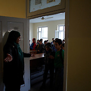 November 11, 2012 - Kabul, Afghanistan: Fourth grade students prepare to leave the last class of the day at Shirino High School in Kabul...After decades without access to education under the Taliban regime, and despite the still existent social stigmas, female students make now 40 per cent of the over all students in the country. (Paulo Nunes dos Santos)