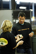 CINCINNATI, OH - OCTOBER 5:  Nick Lachey hands a can of food to a volunteer during the kickoff to The Everybody Wins Tour at Freestore Foodbank on October 5, 2009 in Cincinnati, Ohio. (Photo by Joe Robbins/WireImage for Foodbank)