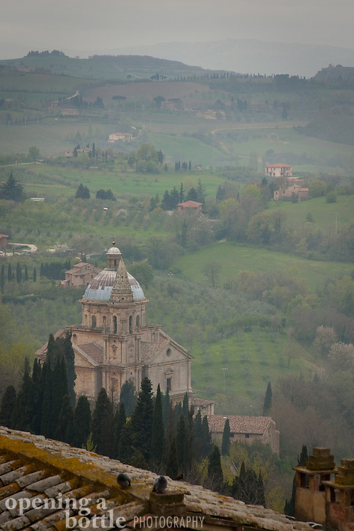 San Biagio Church and the rolling Tuscan countryside in fog, from Montepulciano, Siena, Tuscany, Italy.