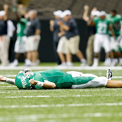 Oct 5, 2013; New Orleans, LA, USA; North Texas Mean Green quarterback Derek Thompson (7) lays on the ground after throwing a touchdown pass against the Tulane Green Wave during the second half at Mercedes-Benz Superdome.Tulane defeated North Texas 24-21. Mandatory Credit: Derick E. Hingle-USA TODAY Sports