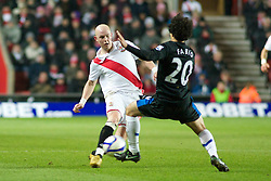 SOUTHAMPTON, ENGLAND - Saturday, January 29, 2011: Manchester United's Fabio and Southampton's Richard Chaplow in action during the FA Cup 4th Round match at St. Mary's Stadium. (Photo by Gareth Davies/Propaganda)