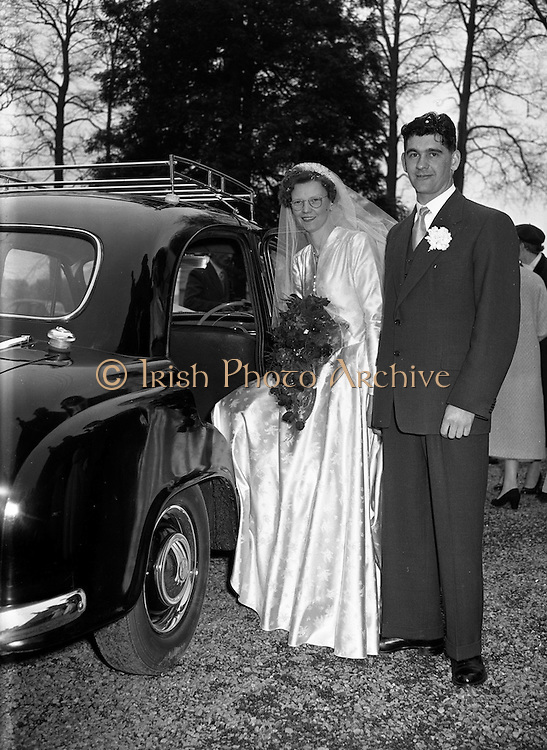 30/03/1957<br /> 03/30/1957<br /> 30 March 1957<br /> Wedding of Lee - Hill at Finglas Parish Church (Church of Ireland) and the Spa Hotel, Lucan, Dublin. Bride and groom getting into the car outside the church.