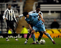 Photo: Jed Wee.<br /> Newcastle United v Celta Vigo. UEFA Cup. 23/11/2006.<br /> <br /> Celta Vigo's Canobbio holds off Newcastle's Charles N'Zogbia.