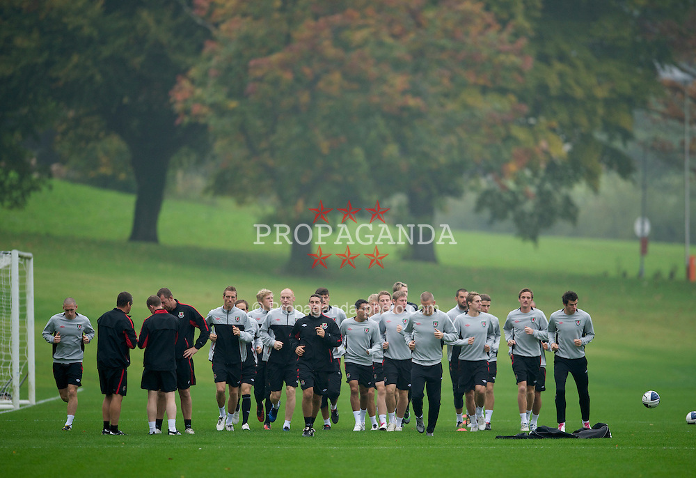 CARDIFF, WALES - Sunday, October 10, 2010: Wales' sports science coach Adam Owen leads the players during a training session at the Vale of Glamorgan ahead of the Euro 2012 qualifying Group G match against Switzerland. (Pic by David Rawcliffe/Propaganda)