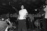 NEW YORK - MARCH 1999:  Rapper Eminem, with unidentified rappers and DJs in the background, performs at Tramps in March 1999 in New York City, New York. (Photo by Catherine McGann)Copyright 2010 Catherine McGann