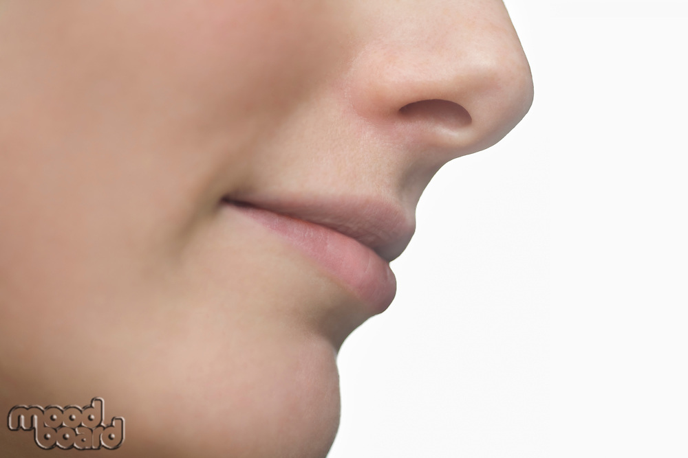 Part of a young womans face showing her lips and nose