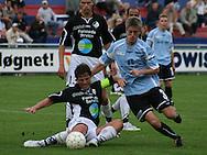 John Sandberg (Randers FC) presses af Marc Kraft (Elite 3000).