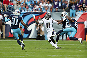 Baltimore Ravens wide receiver Breshad Perriman (11) looks up for a first quarter pass broken up by Tennessee Titans rookie cornerback Adoree' Jackson (25) and Titans cornerback Logan Ryan (26) and intercepted by Titans free safety Kevin Byard (31) during the 2017 NFL week 9 regular season football game against the Tennessee Titans, Sunday, Nov. 5, 2017 in Nashville, Tenn. The Titans won the game 23-20. (©Paul Anthony Spinelli)