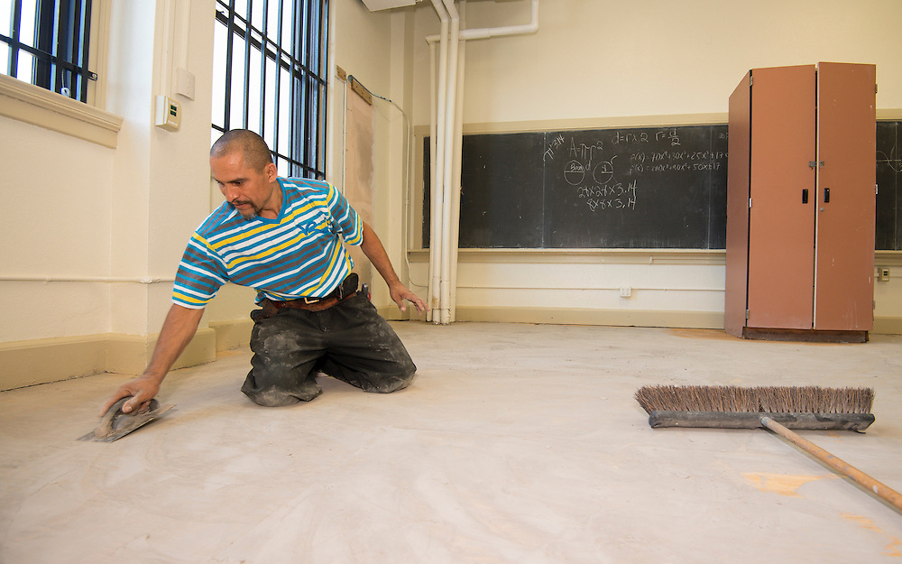 Workmen prepare the Baylor College of Medicine Academy at Ryan for the opening of school.