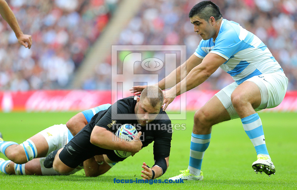 Owen Franks of New Zealand is tackled by Juan Martin Fernandez Lobbe ( hidden ) and Francisco Nahuel Tetaz of Argentina during the 2015 Rugby World Cup match at Wembley Stadium, London<br /> Picture by Paul Terry/Focus Images Ltd +44 7545 642257<br /> 20/09/2015
