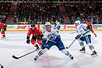 PENTICTON, CANADA - SEPTEMBER 10: Brett Pollock #60 of Calgary Flames back checks Zack MacEwen #64 of Vancouver Canucks at centre ice on September 10, 2017 at the South Okanagan Event Centre in Penticton, British Columbia, Canada.  (Photo by Marissa Baecker/Shoot the Breeze)  *** Local Caption ***