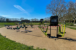 © Licensed to London News Pictures. 24/03/2020. London, UK. Outdoor gym equipment taped off in a north London park on the first day of the coronavirus lockdown in the UK. BORIS JOHNSON has ordered outdoor gyms across the UK to be shut during the coronavirus lockdown. Photo credit: Dinendra Haria/LNP