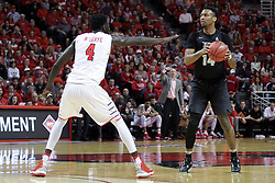 "20 March 2017:  Nick Banyard defended by Daouda ""David"" Ndiaye (4) during a College NIT (National Invitational Tournament) 2nd round mens basketball game between the UCF (University of Central Florida) Knights and Illinois State Redbirds in  Redbird Arena, Normal IL"