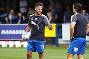 AFC Wimbledon attacker Harry Forrester (11) warming up and talking to AFC Wimbledon attacker Egli Kaja (21) during the EFL Sky Bet League 1 match between AFC Wimbledon and Doncaster Rovers at the Cherry Red Records Stadium, Kingston, England on 26 August 2017. Photo by Matthew Redman.