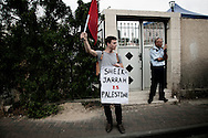 JERUSALEM :  An Israeli activist  demonstrates during the weekly protest in the mostly Arab neighborhood of Sheikh Jarrah in east Jerusalem on April 30 , 2010.