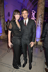 ROBERT KONJIC and NIKKI HUNTER at a private view of Alexander McQueen's Savage Beauty exhibition hosted by Samsung BlueHouse at the V&A, London on 30th March 2015.