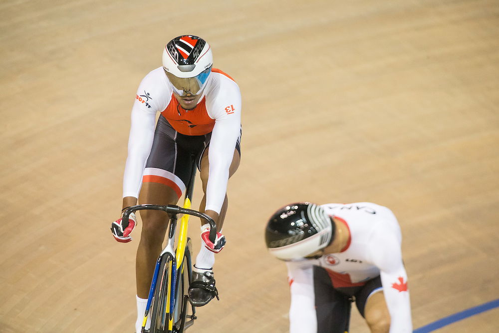 Njisane Phillip (L) of Trinidad and Tobago and<br /> Joseph Veloce of Canada keep it for the other to make a move during the men's cycling sprint quarterfinals at the 2015 Pan American Games in Toronto, Canada, July 17,  2015.  AFP PHOTO/GEOFF ROBINS