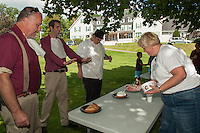 Bob McKinney, Scott Pelchat and Brandon Rutherford watch as Liz Pomeroy loads on the whipped cream for the pie eating contest during Staff Appreciation Week at the Taylor Home Community Friday afternoon.  (Karen Bobotas/for the Laconia Daily Sun)