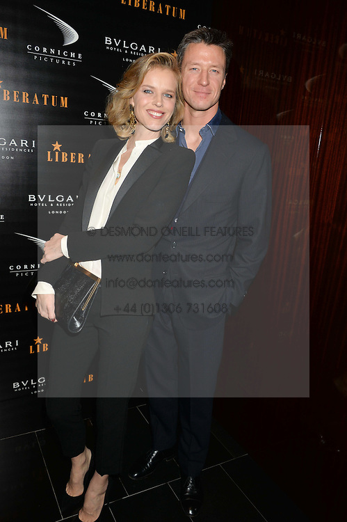 EVA HERZIGOVA and GREGORIO MARSIAJ at a dinner hosted by Liberatum to honour Francis Ford Coppola held at the Bulgari Hotel & Residences, 171 Knightsbridge, London on 17th November 2014.