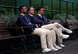 Line judges sit on a bench as they wait for play to start on day three of the Wimbledon Championships at the All England Lawn Tennis and Croquet Club, Wimbledon.