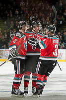 KELOWNA, CANADA - NOVEMBER 9:  Jesse Lees #2, Myles Bell #29 and Riley Stadel #3 of the Kelowna Rockets celebrate a goal against the Red Deer Rebels at the Kelowna Rockets on November 9, 2012 at Prospera Place in Kelowna, British Columbia, Canada (Photo by Marissa Baecker/Shoot the Breeze) *** Local Caption ***