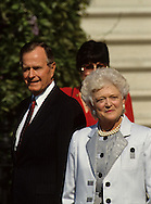 President H W Bush (Bush 41) and First Lady Barbara Bush wait at an arrival ceremony for Carlos Perez President of Venezuela in May 1990...Photograph by Dennis Brack bb25