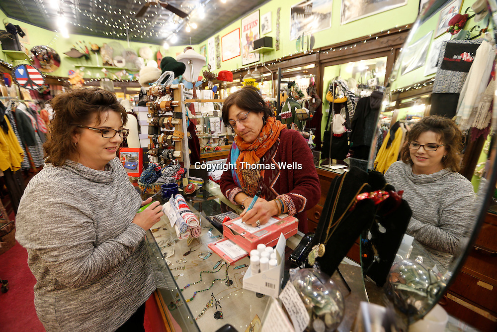 Thomas Wells | BUY AT PHOTOS.DJOURNAL.COM<br /> Teresa Irwin, left, gets checked out by The Main Attraction store owner Barbara Fleishhacker as Irwin finishes up a few last minute Christmas gifts.