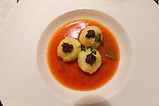 Bad St. Leonhard, Carinthia, Austria. Trippolts Zum Bären gourmet restaurant.<br /> Gefüllte Ochsenschwanzknöderl im roten Lorbeerpaprika-Lavendelbalsam.