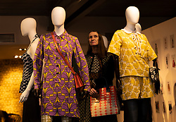 Fashion designer, Orla Kiely, opens her exhibition Life in Pattern at the Dovecot Studios in Edinburgh on 7 February.<br /> <br /> The exhibition draws on Kiely's archives, offering visitors an unparalleled insight into her methods and concepts, with sketches, mood boards, and samples spanning 20 years of work.<br /> <br /> Pictured: Orla Kiely with a selection of her clothing