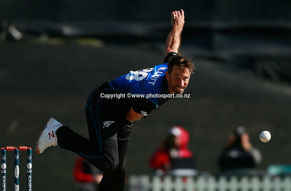 Grant Elliott of New Zealand bowling during the ICC Cricket World Cup warm up game between New Zealand v South Africa at Hagley Oval, Christchurch. 11 February 2015 Photo: Joseph Johnson / www.photosport.co.nz