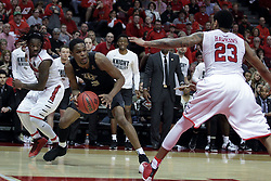 20 March 2017:  A.J. Davis between Paris Lee(1) and Deontae Hawkins(23) during a College NIT (National Invitational Tournament) 2nd round mens basketball game between the UCF (University of Central Florida) Knights and Illinois State Redbirds in  Redbird Arena, Normal IL