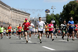 May 26, 2019 - Kyiv, Ukraine - Runners move along Khreshchatyk Street after taking off Maidan Nezalezhnosti during the 27th edition of the Chestnut Run, Kyiv, capital of Ukraine, May 26, 2019. One of Ukraine's largest charity events has been taking place in the capital around the Kyiv Day since 1993. The proceeds of the Chestnut Run are traditionally used to purchase equipment and supplies for the pediatric cardiology centre in Kyiv. Ukrinform. (Credit Image: © Danil Shamkin/Ukrinform via ZUMA Wire)