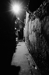 Narrow alley of hutong at night in Beijing China