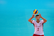 Michal Winiarski from Poland receives the ball during the 2013 CEV VELUX Volleyball European Championship match between Poland and Turkey at Ergo Arena in Gdansk on September 20, 2013.<br /> <br /> Poland, Gdansk, September 20, 2013<br /> <br /> Picture also available in RAW (NEF) or TIFF format on special request.<br /> <br /> For editorial use only. Any commercial or promotional use requires permission.<br /> <br /> Mandatory credit:<br /> Photo by &copy; Adam Nurkiewicz / Mediasport