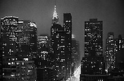 Snow falls against a night sky. In January 1996, a winter blizzard dumped ~20 inches of snow on New York City, closing schools and disrupting traffic.