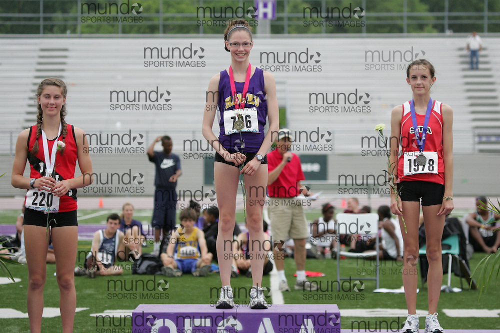 (London, Ontario}---05 June 2010) Natalia Hawthorn of Bracebridge & Muskoka - Braceb  , Rebecca Wendt of Henry Street - Whitby  and Hilary Stafford of St.Thomas Aquinas - London   receive their medals at the 2010 OFSAA Ontario High School Track and Field Championships in London, Ontario,  June 05, 2010. Photograph copyright Julie Robins / Mundo Sport Images, 2010.